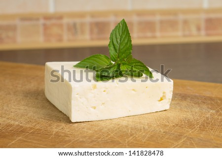 White salted cheese with mint sprig