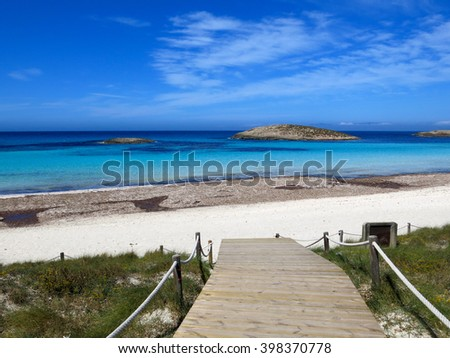White sand and blue sea at Platja de ses Illetes, a heavenly beach in Formentera (Balearic Islands) - stock photo
