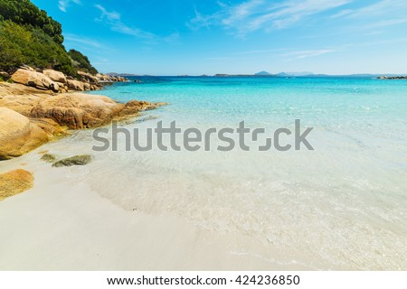 white sand and blue sea in Capriccioli beach, Sardinia - stock photo