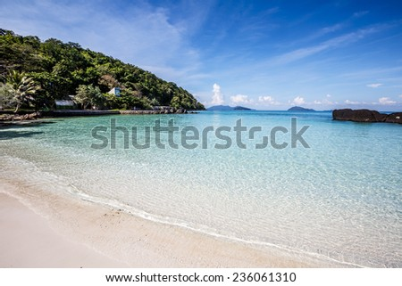 white sand and blue sky on beautiful beach