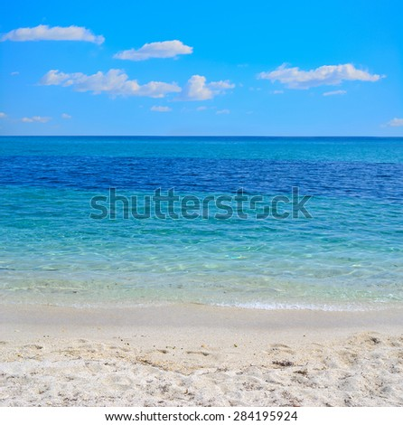 white sand and turquoise water in Sardinia, Italy - stock photo