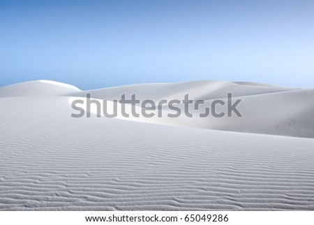 white sand dune and blue sky