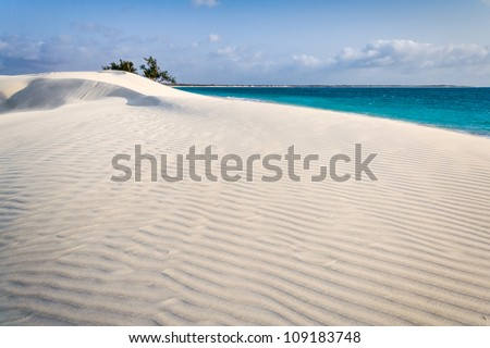 White sand dune by the sea in southern Madagascar - stock photo