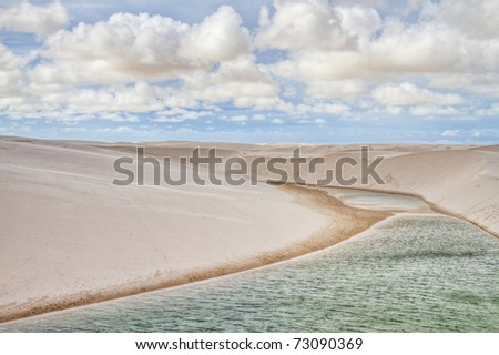 White sand dunes and Green water of the Lencois Maranheses National Park in Brazil, part of UNESCO Cultural Patrimony of the Humanity - stock photo