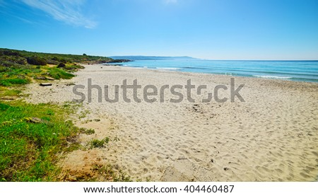 white sand in Le Bombarde beach, Italy