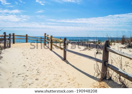 White sand leads to the beach in Surf City on Long Beach Island along the Jersey Shore. - stock photo