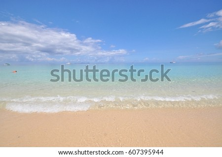 white sand light blue sea with clear sky
