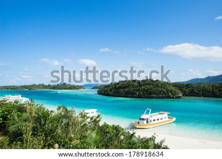 White sandy beach with clear blue lagoon water, Okinawa, tropical Japan  - stock photo
