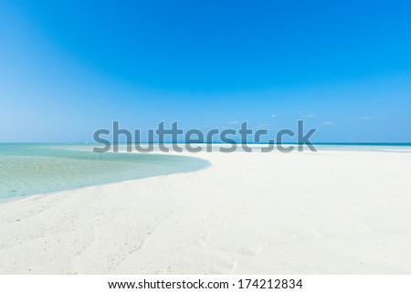 White sandy tropical beach paradise with clear water and sunny blue sky, Taketomi Island of the Yaeyama Islands, Okinawa, Japan - stock photo