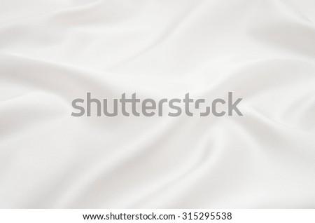 white satin fabric as background - stock photo