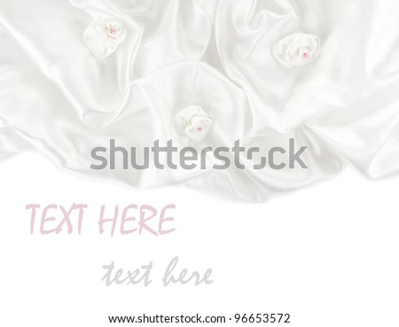 White satin fabric roses and a white background 3