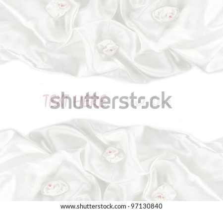White satin fabric roses and a white background - stock photo