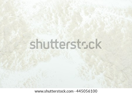 white scattered powder similar to flour. Abstract background.