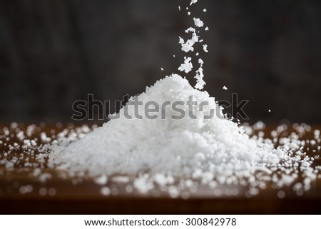 white sea salt crystals with dark background - stock photo
