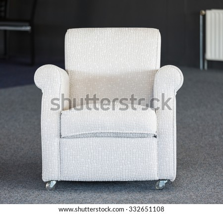White second-hand chair in a furniture warehouse - stock photo