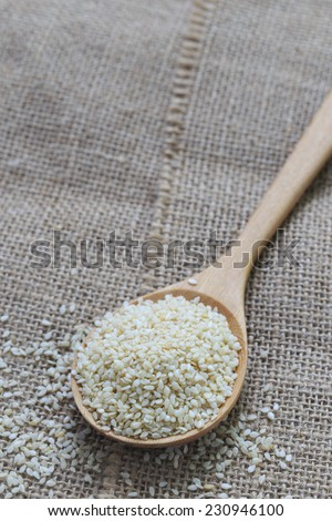 white sesame in wooden spoon