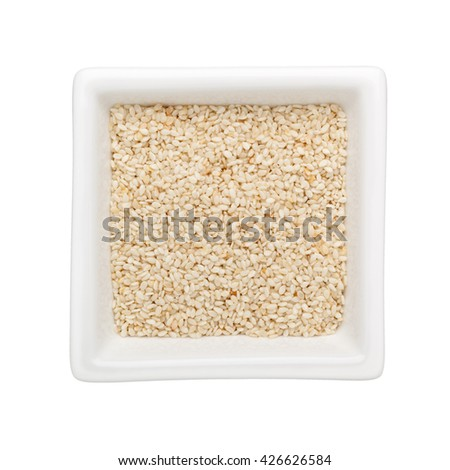 White sesame seeds in a square bowl isolated on white background - stock photo