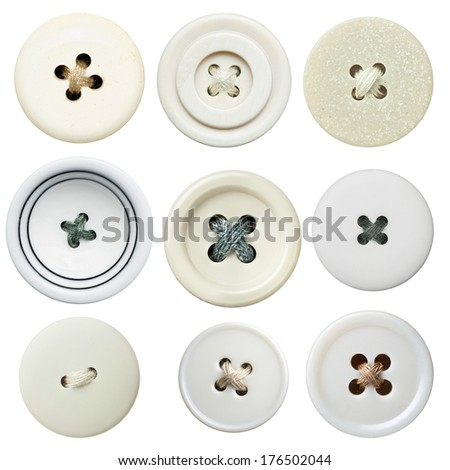White sewing buttons with a thread. - stock photo