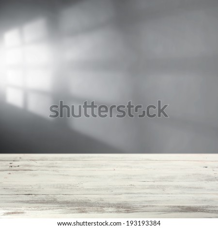 white shabby table with wall and gray shadow  - stock photo