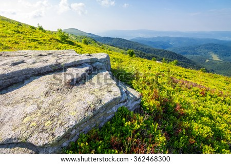 white sharp stones on the hillside meadow on top of mountain range - stock photo