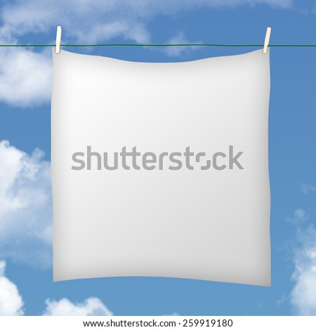 White sheet hanging on clothesline against cloudy blue sky - stock photo