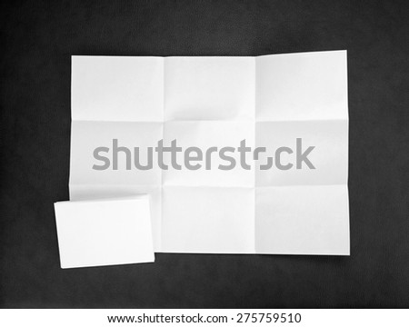 White sheet of paper folded in nine top shooting - stock photo