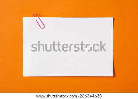 white sheet of paper for notes and paper clip