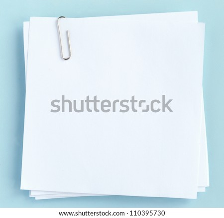 white sheet of paper on a blue background - stock photo