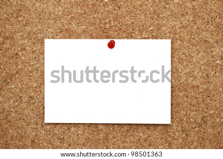 white sheet of paper pinned to cork  bulletin board
