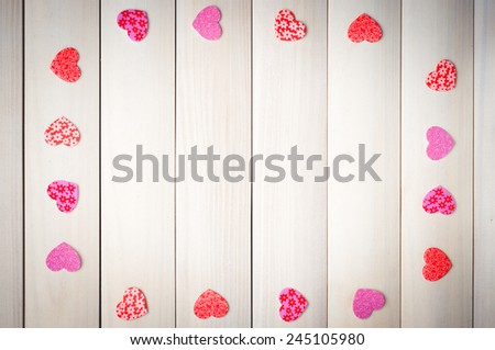 White sheet surrounded by hearts on the background of boards. Background Valentines Day. Valentines Day. Valentines day ideas. Valentines day cards. International women's day. Women's day. March 8. - stock photo