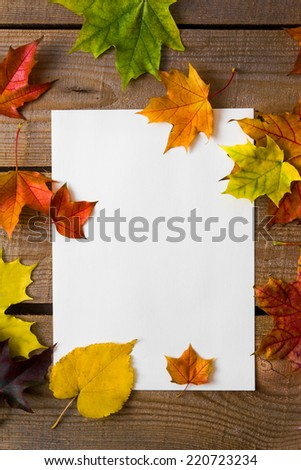 White sheet with autumn leaves  - stock photo