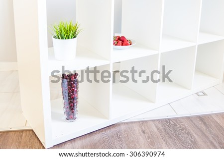 White shelves in a bright room interior - stock photo