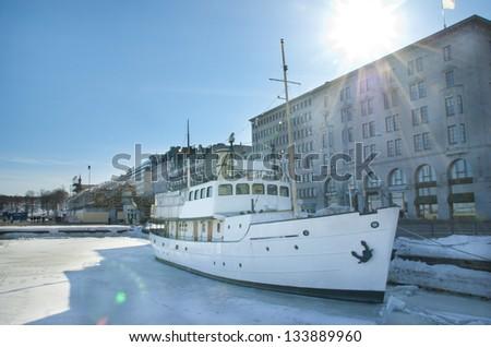 White ship in spring sun rays in Helsinki - stock photo