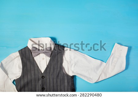 white shirt, gray vest and a bow tie on a bright blue background, the concept of the festival, celebrations, ceremonies happy Father's Day, Happy Birthday Dad