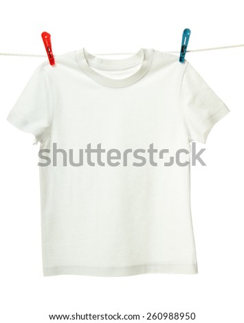 White shirt hanging on the clothesline. Image isolated on white background   - stock photo
