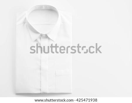 White shirt on white background - stock photo