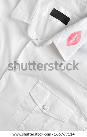 White shirt with kiss lipstick - stock photo