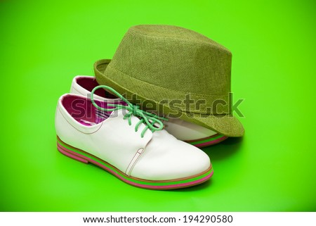 white shoes and green hat - stock photo