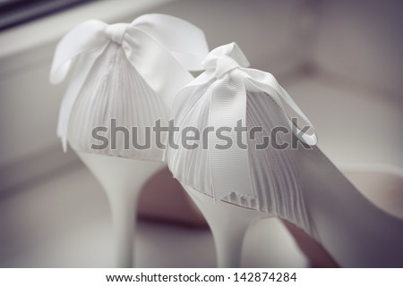White shoes of the bride close-up - stock photo