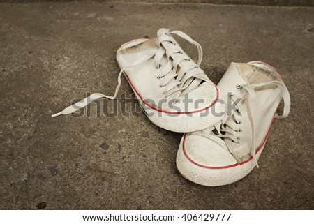 White shoes on background of cement.