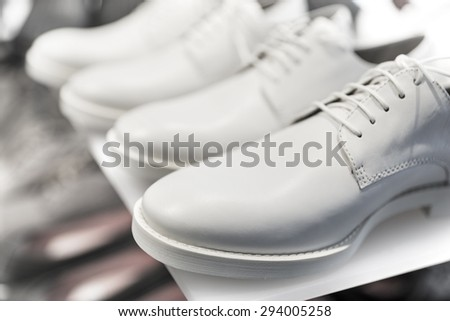 White shoes on display in shoe shop - stock photo