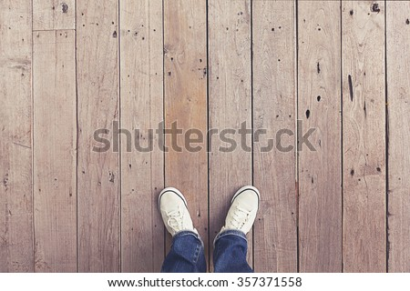 white shoes on wooden planked floor from above - stock photo