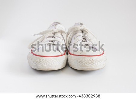White shoes trimmed in red on white background.