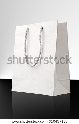 White shopping bag with reflection - stock photo