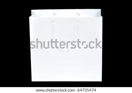 White shopping paper bag on black background - stock photo