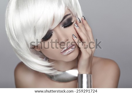 White Short Hair. Eye makeup. Fashion Blond Girl. Beauty Portrait Woman. Isolated on Grey Background. Face Close-up. Hairstyle. Fringe. Vogue Style. - stock photo