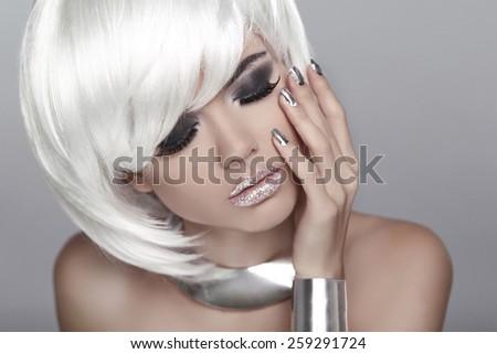 White Short Hair. Eye makeup. Fashion Blond Girl. Beauty Portrait Woman. Isolated on Grey Background. Face Close-up. Hairstyle. Fringe. Vogue Style. - stock photo