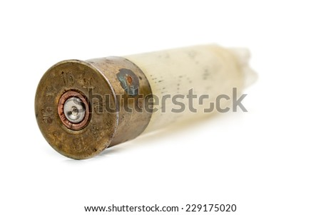 white shotgun shell isolated on white - stock photo