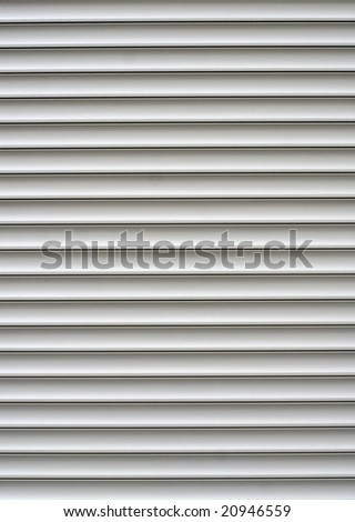 White shutters over a shop doors - stock photo