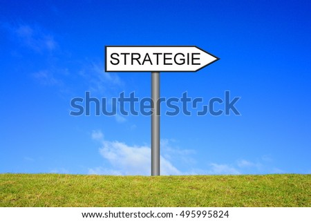 White signpost is showing strategy in german language